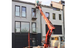 travaux de façade sur grue élévatrice