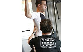 personal trainer giving advice to his client