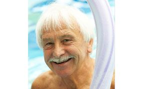 old man smiling in a pool