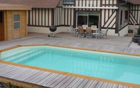 Construction de piscine bois b ton hors sol dans le for Construction piscine brabant wallon