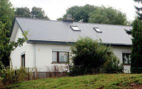 maison avec toiture traditionnelle
