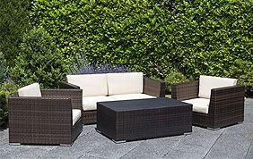 jardin avec terrasse, haie et meubles