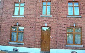 maison à Liège avec menuiseries extérieures en bois