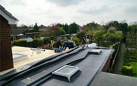 pose roofing sur toiture plate
