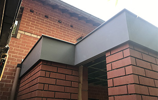 bardage sur façade en brique