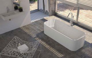 Salle de bain avec sol en béton ciré et baignoire centrale
