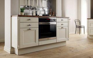 cuisinière avec four encastrable et tiroirs