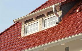 lucarne sur toiture en tuiles