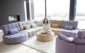 salon en cuir : canapé, pouf, fauteuils