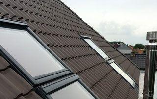 placement de nouveaux velux sur un toit