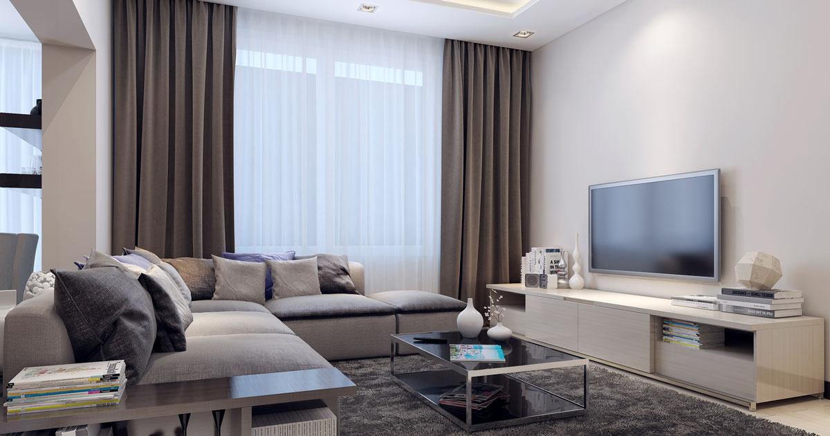 salon moderne avec un canapé d'angle et des rideaux occultants