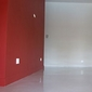 mur rouge repeint
