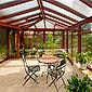 véranda en bois et toit en polycarbonate