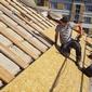 couvreur sur un toit