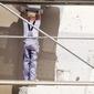 ouvrier échafaudage façade