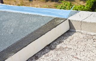 Matériau isolant toiture plate